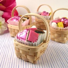 Mini baskets with small cupcake liners, filled with candy. Very cute!