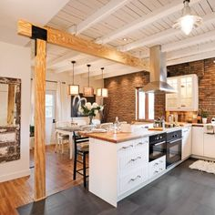 use of beam and the difference in flooring...not sure I like it but we could probably do it better