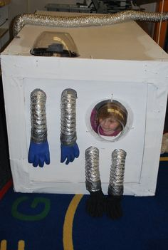 "Space station - dryer vent tubes attached to rubber gloves used for space exploration & cheap plastic bowls make lookouts... from Laguna Preschool Curriculum ("",)"