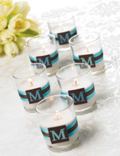 Michaels.com Wedding Department: Ribbon Wrapped Monogram Votive Candles These romantic monogrammed candle holders are the perfect complement to your wedding decor. They can also double as wedding favors for your guests. Using your choice of ribbon and cardstock, you can easily dress these up to match the theme of your wedding. Designed by Michaels Design Team