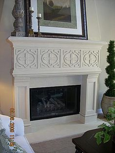 Stone fireplace mantel and Mediterranean living rooms
