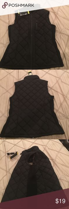 Andrew Marc fitted Vest Black fitted vest, never worn.  Form fitted with sweater like material on both sides.  Black zipper front with hidden zipper pockets.  Matching zipper pocket on the upper left side for added style.  Fully lined, makes a fashion statement. Andrew Marc Jackets & Coats Vests