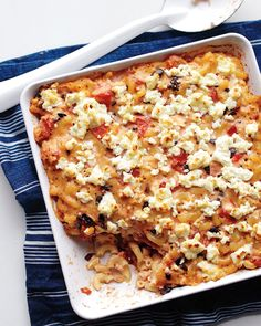 Jim Raftus, a reader from Elkhart, Indiana, uses the sunny flavors of tomato, olives, and feta in this mac and cheese.