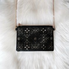 Laser Cut Gold Foil Crossbody/Clutch Laser cut gold foil detail on the front. The chain is detachable so it can also be used as a clutch. No flaws, in perfect condition! Bags