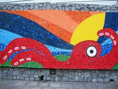 """Portion of a bottle cap mural created by the Planetario Alfa, San Pedro Garza Garcia, Nuevo Leon, Mexico, in association with the Smithsonian traveling exhibition """"Green Revolution.""""   Image courtesy Angelica Flores.  http://www.sites.si.edu/greenRevolution/index.htm"""