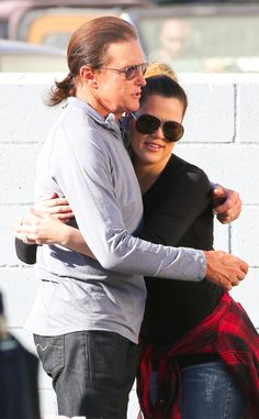 Khloe Kardashian Odom, in modernized 'n' oversized aviator sunnies, gave her stepdad Bruce Jenner some love! The two hugged it out at the family's charity yard sale. How sweet?!