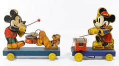 """Lot 484: Fischer Price #798 """"Mickey Mouse"""" and #530 """"Mickey Mouse Band"""" Pull Toys; Two items each having stamped maker marks"""