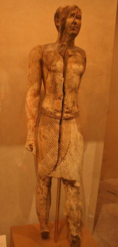 Statue of Kaipunesut, probably Dyn 4, time of Djedefre (ca 2528-2520 BC ), Accacia wood, MM of Art, NY