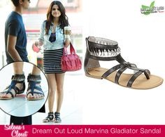 Selena Gomez was photographed on set of her Dream Out Loud photo shoot donning a pair of Dream Out Loud Gladiator Marvina Sandals in color Black/Silver. These sandals can be yours from Kmart.com for $24.99.  Buy it HERE.  She's also wearing the Tan/Orange color in another photo.  These sandals accessorised her Acid Wash Shirt and Bodycon Skirt, both Dream Out Loud.