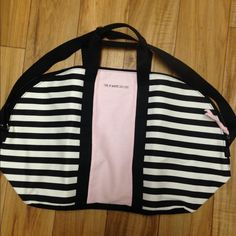 Brand new Victoria's Secret overnight bag Pink/black/white brand new Victoria secret overnight bag..I have a ton so I'm selling Victoria's Secret Bags Travel Bags
