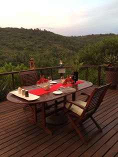 Romantic dinner for 2 on the view deck at Sibuya Bush Lodge.  Kenton on Sea, Eastern Cape, South Africa www.sibuya.co.za Dinner For 2, Outdoor Tables, Outdoor Decor, Romantic Dinners, Resorts, South Africa, Cape, Exotic, Destinations