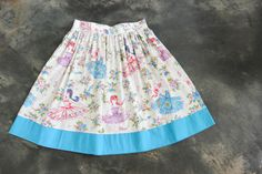 "Ballerina naughtyskirt with a contrast blue trim.32"" waist, 23"" length The naughtyskirt features a super full skirt at an elegant length,  An invisible zip to wear at the side OR back and a sturdy waist band to hold its shape. The naughtyskirt is a trans-seasonal staple! Team with a classic tucked in tee, your favourite sandals and large sunglasses in warmer months. Or wear with tights, boots and cardigans to keep you smiling when the weather is a little bit misera..."
