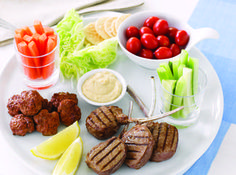 This healthy grazing plate for kids includes delicious lamb meatballs, cutlets, hummus, veggie sticks, tomatoes, lettuce, rice crackers and lemon. Perfect for toddlers who love a bit of everything!