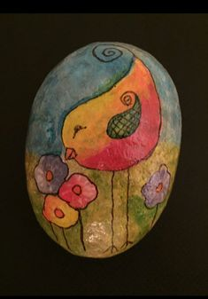 Great use of color on a painted rock.