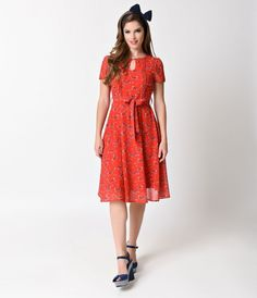 Get ready to ride tandem! Fresh from Lindy Bop, Bretta is a charming red tea dress made from lightweight chiffon style fabric enhanced with a delightful bicycle print! The round neckline has a lovely keyhole cutout and short sleeves. Pleated details, conc