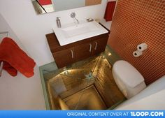 Bathroom with glass floor built above an abandoned elevator shaft. I feel like I would have no problem doing my business with that view!