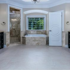 Spa-like master bathroom that was meticulously done with marble flooring, four sinks, a soaking tub, rain shower with multiple shower heads and dual walk-in closets. Listed by The Casey Samson Team in Oakton, VA a Wall Street Journal Top Team in Northern Virginia.