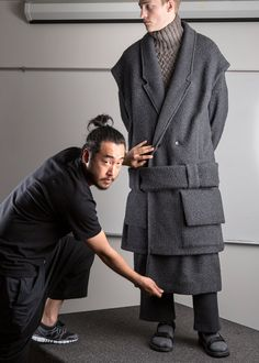Designer Sang Hup Park with model Victor Nylander behind the scenes at Parsons Fashion Show