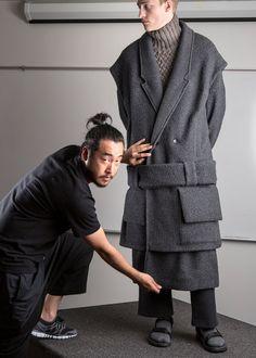 Designer Sang Hup Park with model Victor Nylander behind the scenes at Parsons Fashion Show