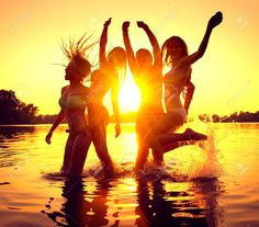 Beach Party. Group Of Happy Girls Dancing In Water On Beautiful ...