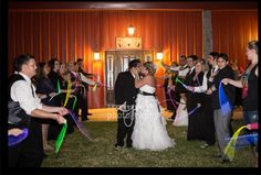 Tin Spur Ranch, Inez, Texas . Glow sticks help make glowing exit for this bride and groom.