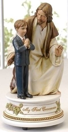 First Communion Little Boy With Jesus Musical Figure The Lords Prayer. While Jesus kneels next to a young prayerful boy this wonderful music box plays the Lord's Prayer. It is an ideal gift for a litt