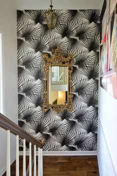 This wallpaper reminds me of the Gaudi wrought iron palm gates in Barcelona.