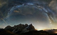 Amazing panorama with stars and mountains