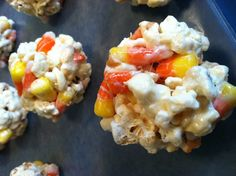 Candy Corn Popcorn Balls - 8oz bag of microwave popcorn, 1 cup candy corn; mix with 1/4 c melted butter, 1 bag of marshmallows and 1/4tsp salt. Perfect mix of sweet & salty! quick treat.