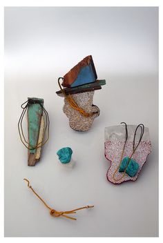 Carolina Hornauer. Mainly constructed with found wood (pieces of houses destroyed after the tsunami, 2010), eggshell, found wire, plaster, paint. http://joyasdelaodisea.blogspot.com/
