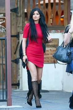 Boot-iful! Kylie Jenner teamed her unusual heels with a tight red dress as she headed out to lunch atSagebrush Cantina in Calabasas on Saturday