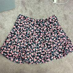 Floral skater skirt Brand-new World skater skirt from H&M. NWT!! H&M Skirts Circle & Skater
