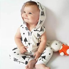 * Arrows print<br /> * Front zip-up closure<br /> * Hooded design<br /> * Material: 80% Cotton, 20% Others<br /> * Machine wash, tumble dry<br /> * Imported<br /> <br /> A soft hooded jumpsuit in charming arrows prints features a full-front zip-up to make dressing and diaper changing a breeze.
