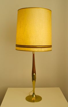 """In love with this table lamp!  Great lines, and it gives a beautiful, warm glow.    Mid-Century table lamp- Wood and gold base    36""""H  13""""W(shade)  SOLD"""