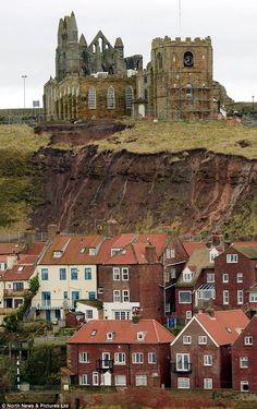 A historic church and graveyard which features in Bram Stoker's Gothic novel Dracula is faced with a horror story of its own.     Human bones uncovered after a landslide last month have been washed down the side of a cliff where St Mary's Church stands in Whitby after heavy rainfall.     The human remains have had to be collected at the bottom of the cliff and then re-buried.
