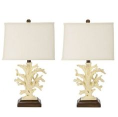 Set of 2 Key West Coral Table Lamps. The ceramic coral accents that adorn the wood base of these lamps provide a contemporary accent to any space Features a rectangle lamp shade made of an off-white linen on each lamp Crafted of ceramic and wood Perfect for a living room, bedroom, den, library, study, or office No assembly required, these table lamps measure 9-inch long by 13-inch deep by 21-inch high