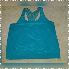 Lane Bryant Top Super cute and fun lane bryant razor back tank top sz 26/28, fits more like a sz 24. Top only worn once, looks brand new!! Lane Bryant Tops Tank Tops
