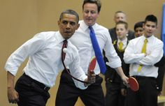 President Obama and Britain's Prime Minister David Cameron play table tennis at Globe Academy, May 24, 2011, in London, England.