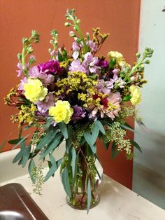 We are loving the combination of yellow and purple accents in our latest arrangement of flowers we designed. Gorgeous!