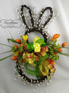 Bunny wreath, with yellow and orange tulips, trimmed with cream pip berries and a designer bow.  He's on SALE on the website!  bunny wreath, rabbit wreath, spring wreath, Easter wreath, wreath with tulips, tulip Easter wreath