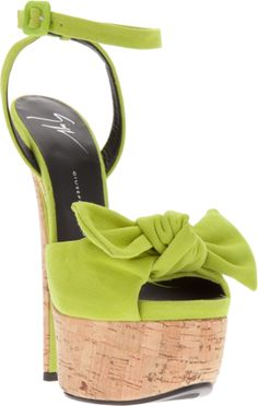 Green suede sandals from Giuseppe Zanotti Design with strap across foot with large bow detail, contrast high stiletto heel.