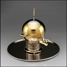 Prototype tea urn, designed by Eliel Saarinen, made by International Silver Company, Wilcox Silver Plate Company Division, ca. 1934, electro-plated nickel silver, brass, and bakelite. Metropolitan Museum of Art