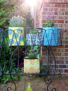 Cassie Stephens: DIY: Kitty Litter Containers to Pattern-y Planters!