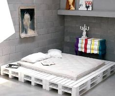 DIY Bed. Pallets and white paint! ;)