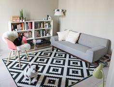 Retro sofa by Miliboo, Hay chair, Ikea graphic rug - minimal style interior with colorful touches