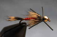 Squirrelly Cuss beadhead nymph with rubber legs. For more fly fishing info follow and subscribe www.theflyreelguide.com. Also check out the original pinners site and support