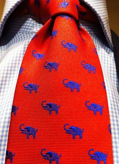 Incorporate your owls and elephants in the clothing! I am thinking ties, bow ties, shirts, pins, scarves, both owls and elephants are super popular at the stores so I am sure you'll be able to find something!