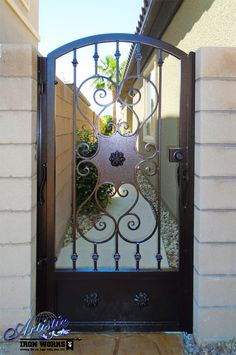 Decorative wrought iron side gate