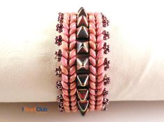 Unleash your wild side with this spiky beaded bracelet created by nestling 6mm Pyramid beads between two rows of Superduos. The Pyramid Row Bracelet tutorial was featured in DIY Jewelry Making Magazine #43! The purchase of this listing is for one PDF (electronic file) for the