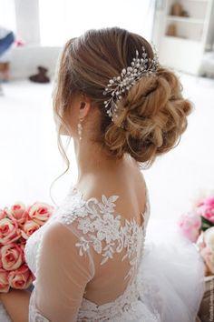 Long Wedding Hairstyles & Bridal Updos via Evgeniya Lebedeva / http://www.himisspuff.com/wedding-hairstyles-from-evgeniya-lebedeva/8/